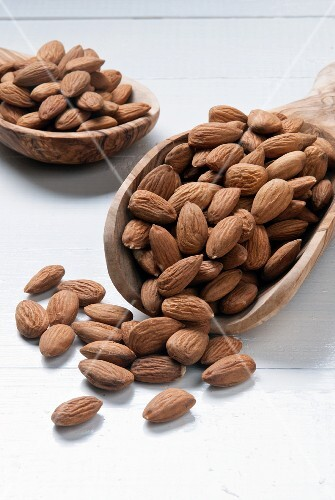 Almonds on wooden scoops