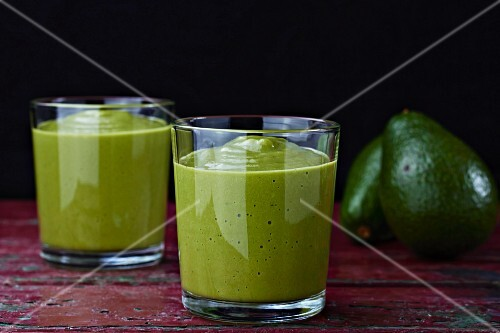 Two glasses of avocado smoothie