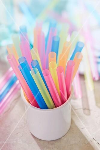 A mug of colourful straws
