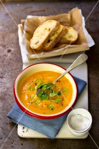 Pumpkin soup with herbs and bread