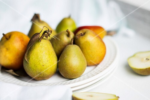Autumn pears on white plate