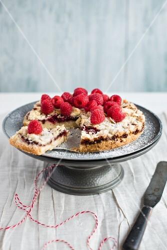 Raspberry tart with almonds, sliced