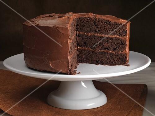 A chocolate cake on a cake stand