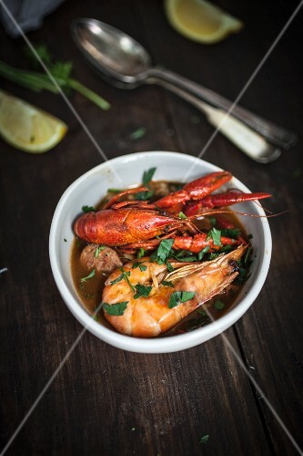 Crayfish stew with king prawns in a soup bowl (Portugal)