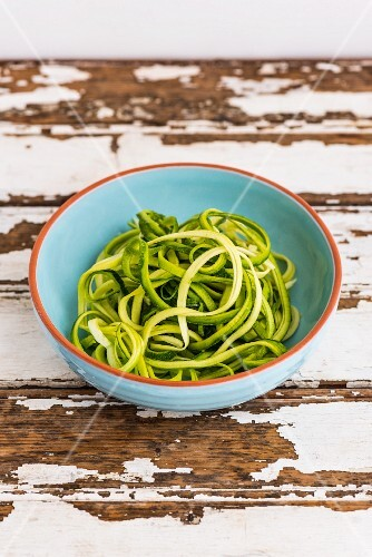 Courgette noodles in a ceramic bowl