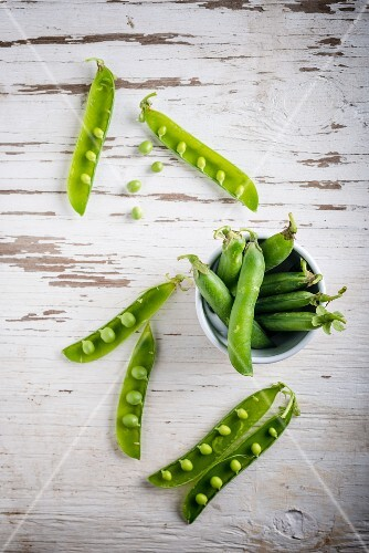 Green peas on a white surface