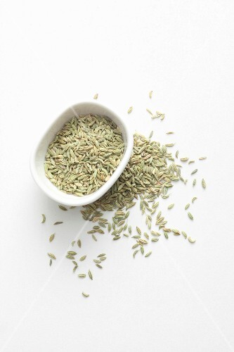 Fennel seeds in a bowl and next to it