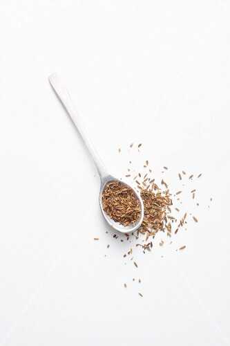 Cumin on a spoon and next to it