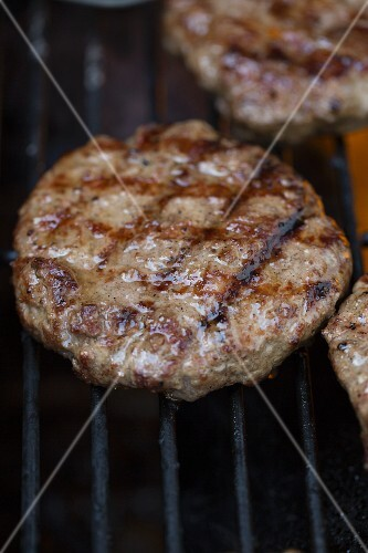 A burger on a barbecue