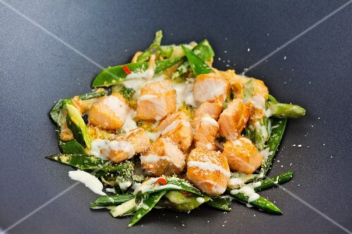 Fried pollack with coconut milk and wok vegetables