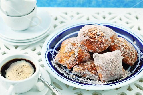 Bread rolls and a cup of coffee