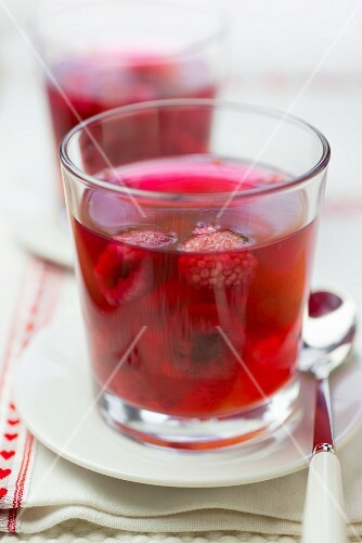 Fruit jelly with raspberries in two glasses