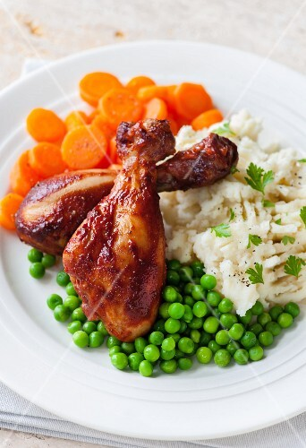 Glazed chicken drumsticks with peas, carrots and mashed potatoes