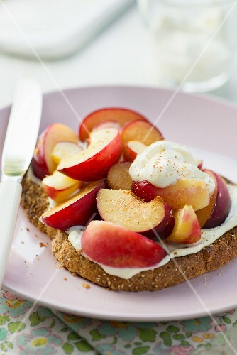 Grilled peaches and plums on toast