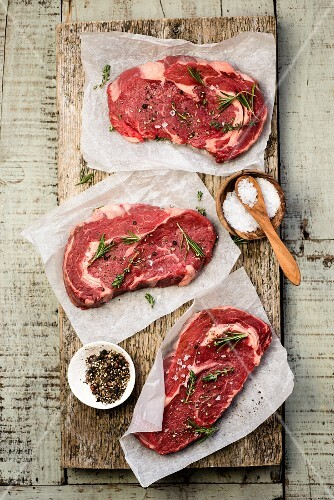Raw beef steaks with spices
