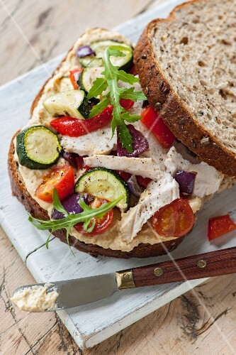 A roasted vegetable and chicken sandwich
