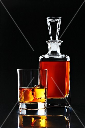 Whiskey in a glass and in a carafe