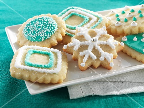 Christmas biscuits decorated with turquoise and white icing