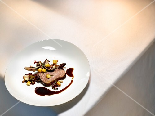 A dish by Joachim Wissler: shoulder of ox braised in Barolo vinegar with radicchio and grape must
