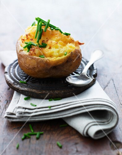 A baked potato filled with cheese and chives