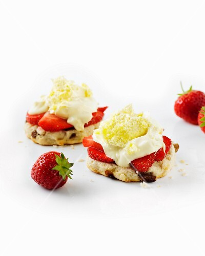Clotted cream and strawberries on scones