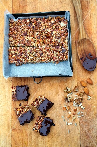 Dried fruit and nut bars with honey and dark chocolate glaze