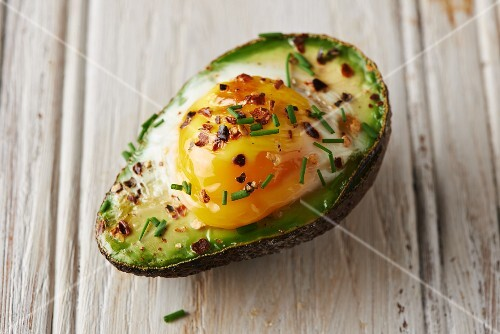 Baked avocado with an egg and chives