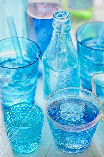Blue drinks in glasses and bottles