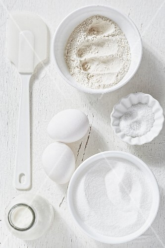Various baking ingredients with a spatula