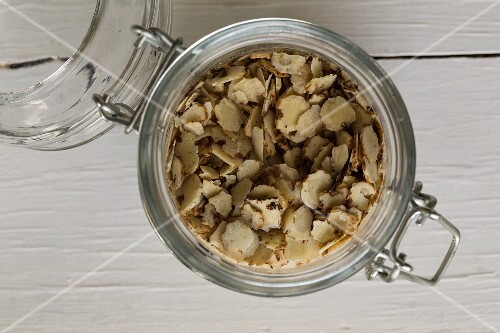 Chufa sedge in a flip-top jar on a white wooden surface