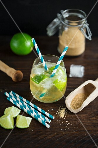 Virgin Caipirinha Cocktail made form ginger ale, limes and brown sugar with straws