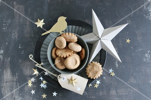 Christmas biscuits on flan tin and stars hand-crafted from paper and gold foil