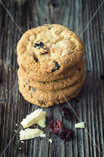 A stack of cookies with white chocolate and dried craberries