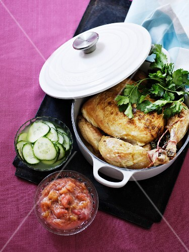 Braised chicken with a cucumber salad and a spicy fruit sauce