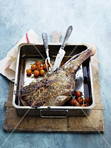 Roasted leg of lamb with cherry tomatoes
