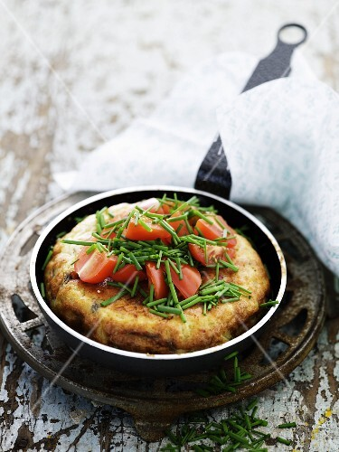 Spanish tortilla with tomatoes and chives