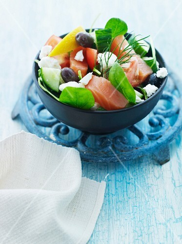 Vegetable salad with salmon, olives and feta cheese