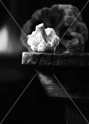 A cauliflower on a wooden table