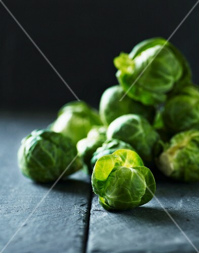 Brussels sprouts on a grey surface