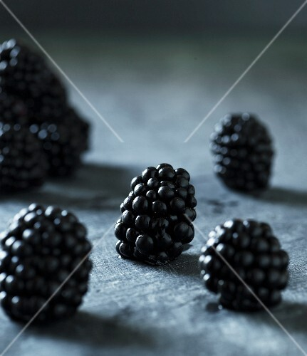 Blackberries on a grey surface