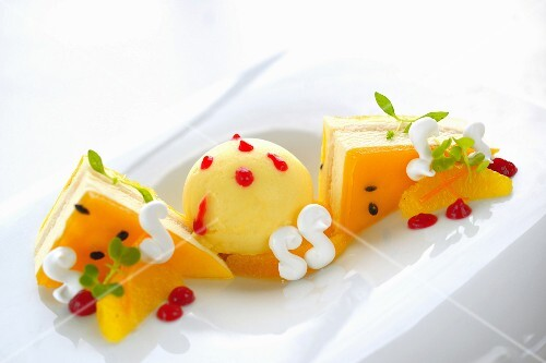 A dessert platter with white chocolate sabayon, meringue and fruit cream slices