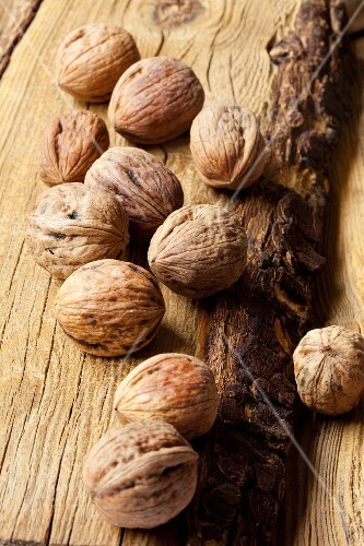 Walnuts on a wooden surface