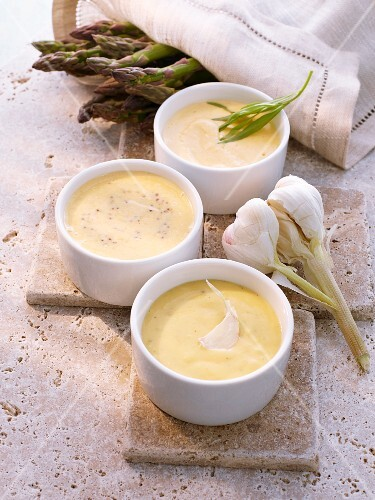 Three asparagus sources: sauce Bearnaise, aioli and honey mustard sauce