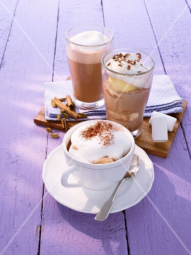 Hot chocolate with marshmallows, iced chocolate, and chai latte