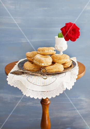 Choux pastry rings with buttercream filling on a round side table