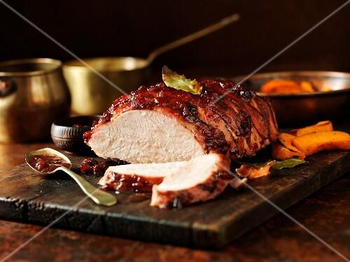 Carved turkey breast on a chopping board