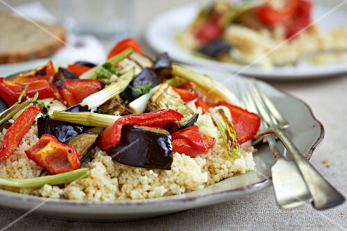 Couscous with aubergines, peppers and spring onions