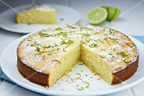 Lime cake with icing sugar and lime zest