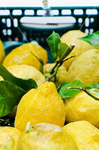 Lemons with leaves in a crate