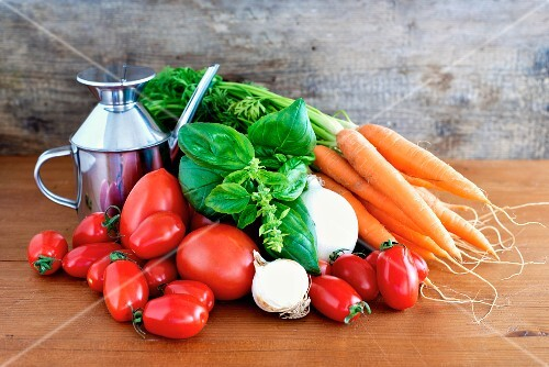 Ingredients for Italian tomato sauce (basil, tomatoes, carrots, onions, garlic and olive oil)